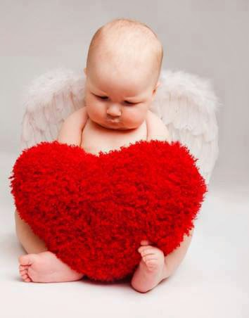 baby with heart pillow wallpaper
