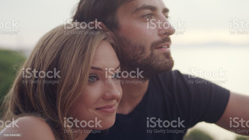 Couple Hugging And Admiring The View. Close Up