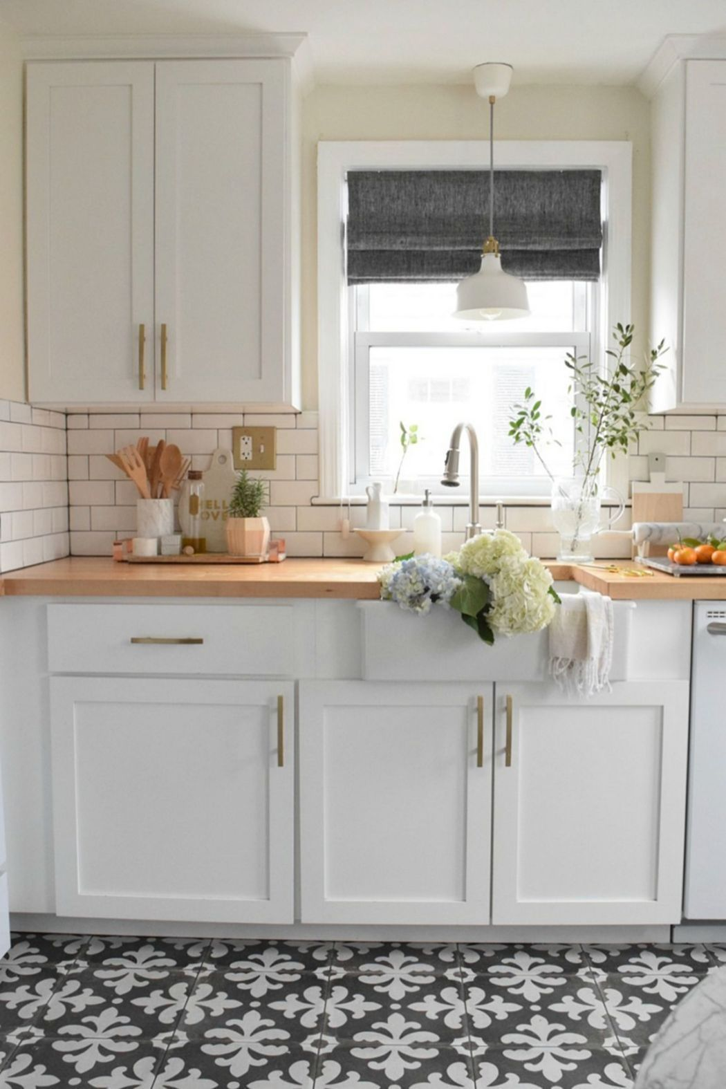 Cute Small Kitchen With Concrete Patterned Tile Floor, White Cabinets, Gold Or Brass Hardware, Butcher Block Wood Countertop And Subway Tile Backsplash #Smallkitchen #Butcherblock #Concretetile