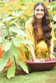 Keerthy Suresh: Keerthy Suresh In Yellow Dress With Cute And Awesome Lovely Smile While Planting A Plant