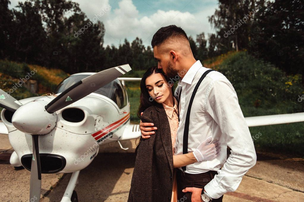 Romantic Couple Hugging While Standing Airplane Background